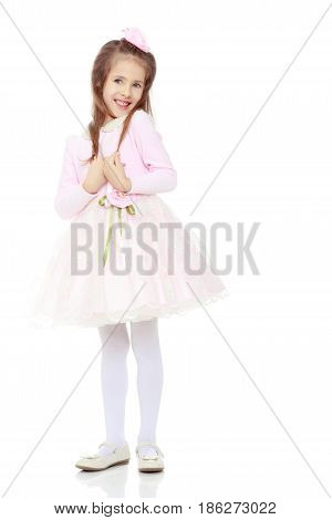 Dressy little girl long blonde hair, beautiful pink dress and a rose in her hair.She pulls my hand through my hair.Isolated on white background.