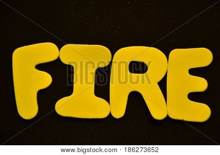 word fire on a  abstract black background