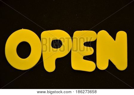word open on a  abstract black background