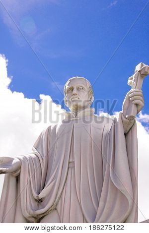 Guam island,USA - May 25, 2016:Statue of Missionary Saint Bitoresu at Dulce Nombre de Maria Cathedral Basilica of Guam Island,USA