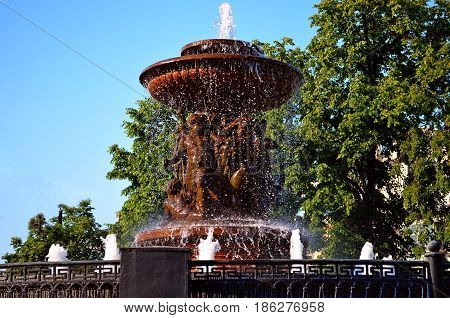 Beautiful and magnificent fountain, in the center of the capital city decorated with angels next to the historic place, attracts tourists, guests and travelers to enjoy the picturesque view