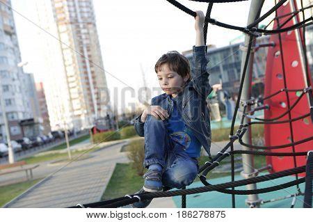 Child Resting At Climbing Net