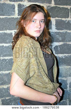 Female beauty fashion model posing in studio basement.