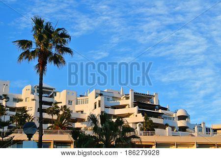 A View To A Resort Building At The Seashore With Palm Trees On Sunny Evening, Torremolinos, Costa De