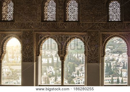 Granada, Spain - February 10, 2015: A View To Old White Houses Of Granada Through A Window Decorated
