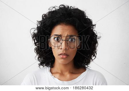 Human Emotions, Feelings, Reaction And Attitude. Startled Mixed Race Girl Wearing Big Round Glasses