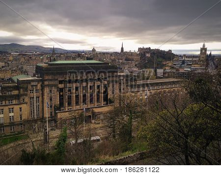 Edinburgh city on dark sky with black clouds view from Calton Hill Scotland UK