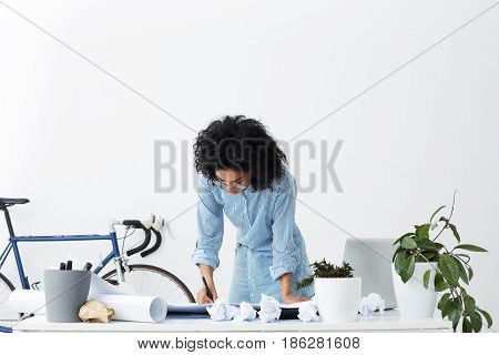 Dark-skinned Young Businesswoman Working On Weekend At Home Office On Important Project Of Her Compa