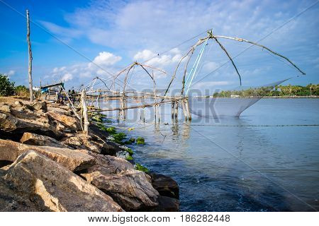 Chinese fishing net on seashore Kerala India