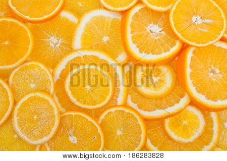 Slices of a ripe orange background close up