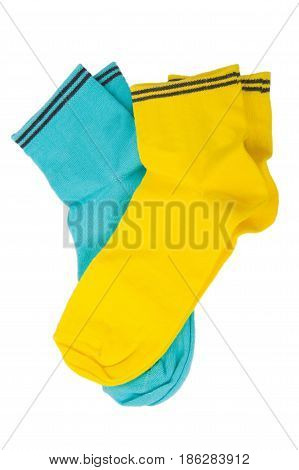 Two pair of blue and yellow socks isolated on white