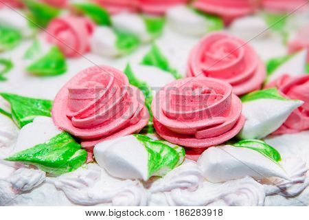 close up tasty cake with roses background