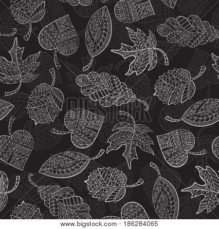 Seamless pattern with autumn leaves painted against a dark background