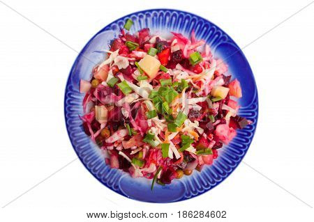 Vegetable salad on a plate with a dark blue border