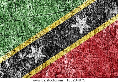 Grudge stone painted Saint Kittis and Nevis flag