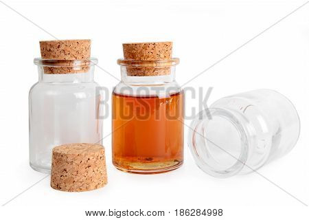 Empty and full glass bottle with cork