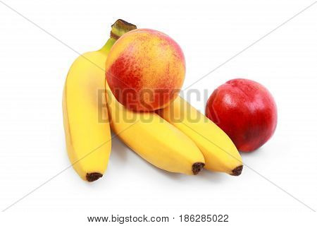 Fresh bananas and peaches on white background peaches and bananas isolated on white - vegeterian healthy food