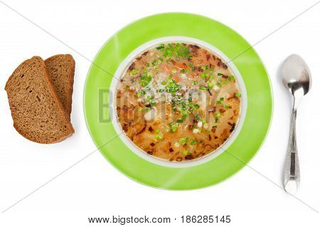 Vegetable soup on a meat broth isolated on the white background