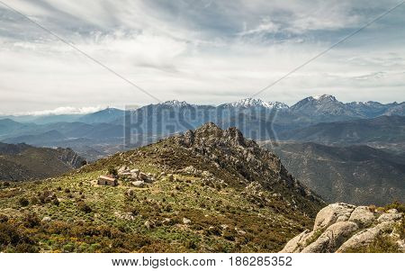 Refuge De Prunincu And Snow Capped Mountains Of Corsica