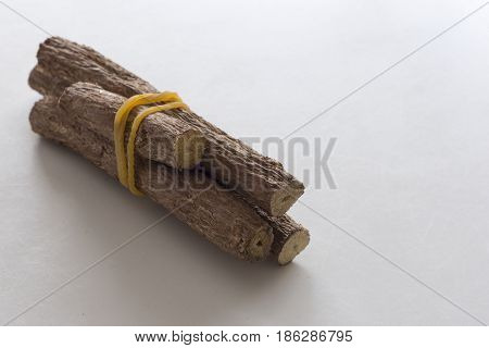 Three pieces of licorice with a white background