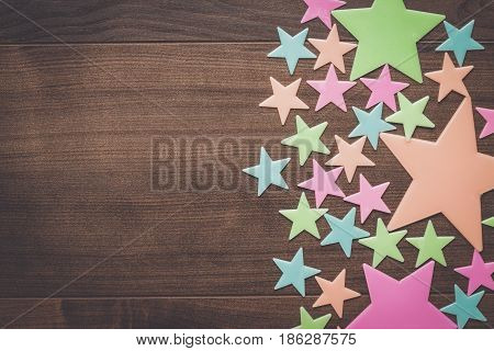 plastic toy stars on the wooden table