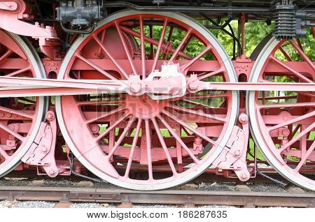 Red Wheels And Pistons On An Old Locomotive