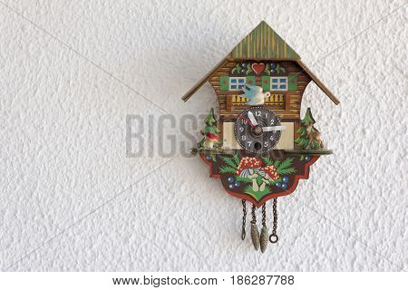 A cuckoo clock hanging on the wall