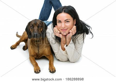 Beautiful young woman with Bavarian mountain hound dog isolated on white background. Copy space.