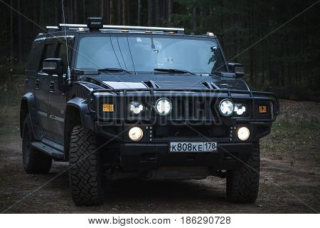 Black Hummer H2 Vehicle, Night Time