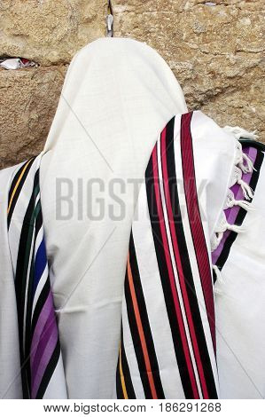JERUSALEM - APRIL 07: Orthodox Jewish man pray at the Western Wall during the Jewish holiday of Passover in Jerusalem Israel. Passover commemorates the liberation of the Israelites from Egyptian slavery