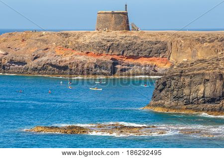 Playa Blanca Lanzarote 04 April 2017: Castle Castillo de las Coloradas on cliff in Playa Blanca Lanzarote Canary Islands Spain