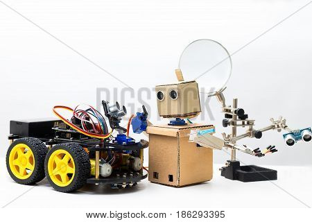 Robot on wheels and robot with hands stand on white background