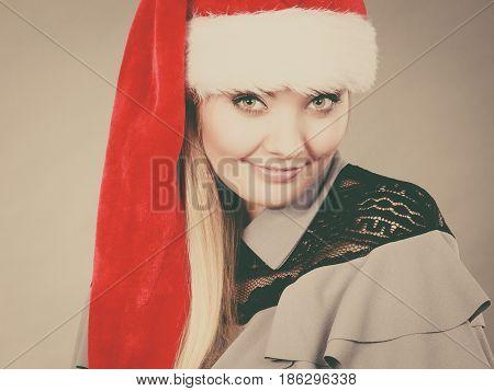 Xmas seasonal clothing winter christmas concept. Happy woman wearing Santa Claus helper hat
