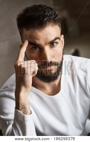 Portrait of handsome bearded man looking at camera.