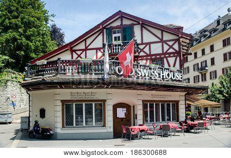 LUCERNE, SWITZERLAND - JUNE 12, 2013: Old Swiss House restaurant in old town of Lucerne. Switzerland. Built in 1858