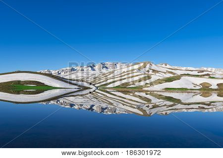 reflections in middle Taurus Mountains & lake