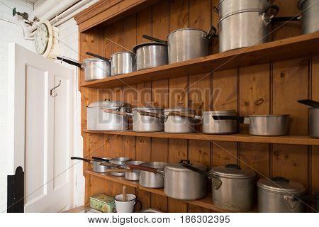 Collection of vintage saucepans on wooden kitch dresser