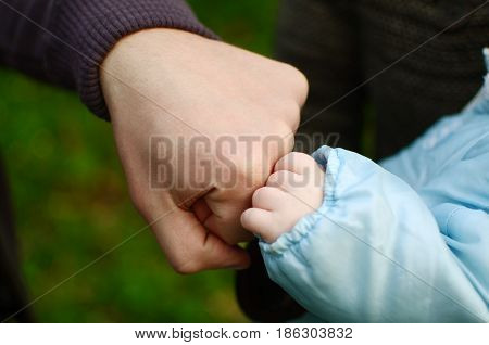 First bump son and father. Male friendship