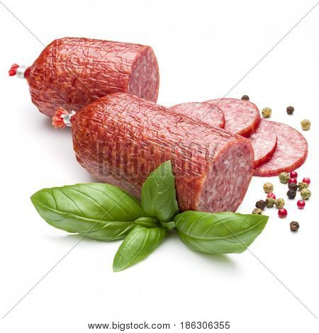 Salami smoked sausage, basil leaves and peppercorns isolated on white background cutout