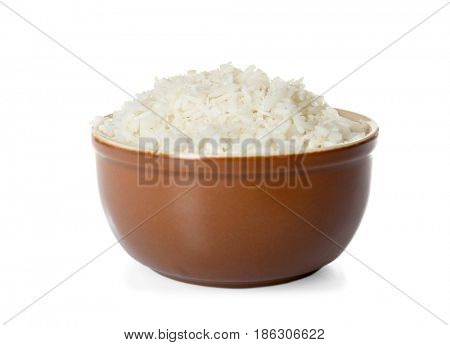 Ceramic bowl with coconut rice on white background