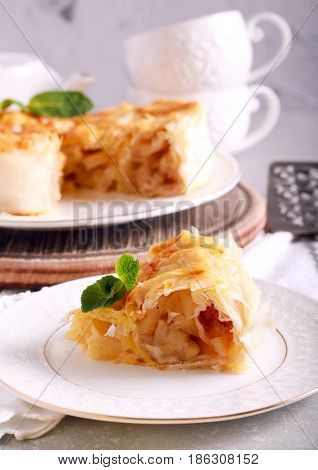 Filo pastry apple pie sliced on plate