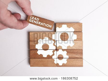 Business, Technology, Internet And Network Concept. Young Businessman Shows The Word: Lead Generatio
