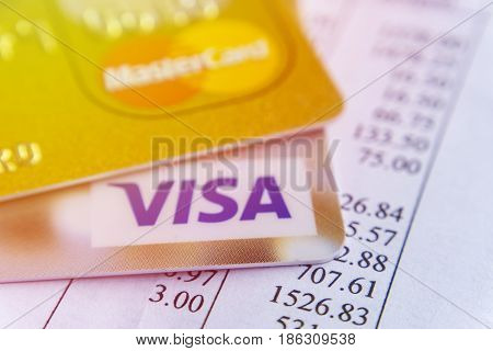 Krasnodar, Russia - May 9, 2017: Master card and VISA cards on the invoice for payment.