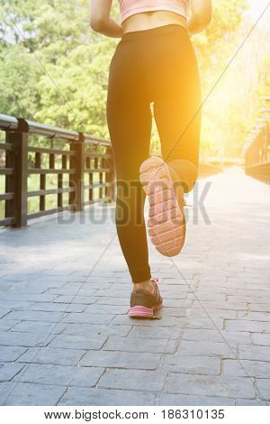 Female Sport Fitness Runner Jogging Outdoors On Bridge In Spring Or Summer. Healthy Young Asian Woma