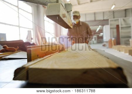 Carpentry saws a long saw with a circular saw on the background of a carpentry workshop