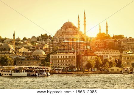 Golden Horn in Istanbul at sunset, Turkey. The Golden Horn is a major urban waterway and the primary inlet of the Bosphorus in Istanbul.