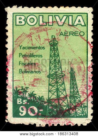 Bolivia - CIRCA 1955: a stamp printed in the Bolivia shows oil derricks, series oil industry, circa 1955