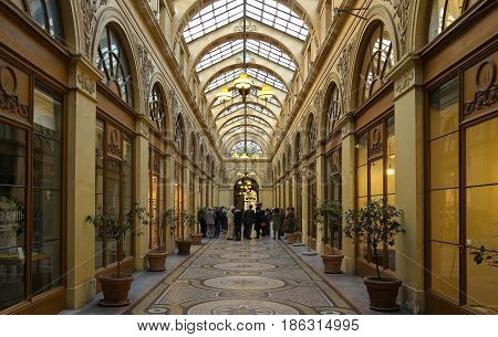 PARIS FRANCE - May 10 2017: Galerie Vivienne is an ancient historical passage with shops and restaurants and a tourist attraction in Paris in France