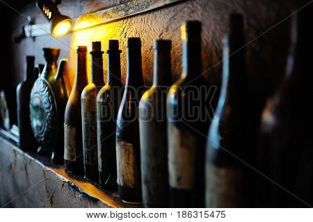 bottles with the old Georgian wine in the wine cellar