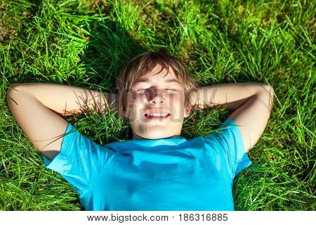 Teenager take a rest on the Green Grass